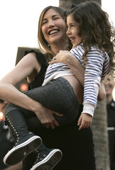 Jackie, wife of actor and comedian Sandler, holds their daughter Sadie Madison as he is honored with a star on the Hollywood Walk of Fame in Hollywood