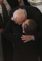 """Actor DiCaprio hugs former Soviet leader Gorbachev as they attend """"Cinema for Peace 2010"""" charity gala in Berlin"""