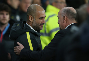 Manchester City manager Pep Guardiola and Hull City manager Mike Phelan before the game