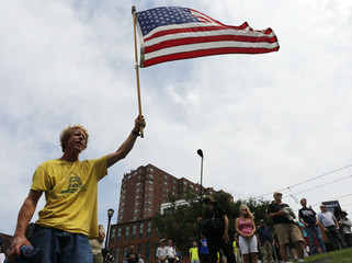A supporter of Republican presidential candidate Donald Trump holds a flag at a pro-Trurmp rally near the Republican National Convention in Cleveland