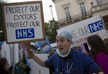 File photograph of protester holding a placard at a demonstration in support of junior doctors in London
