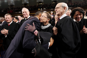 President Barack Obama hugs Supreme Court Justice Ruth Bader Ginsburg prior to delivering his State of the Union address on Capitol Hill in Washington