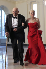 U.S. Congressman John Dingell and his wife Deborah arrive for a State Dinner at the White House in Washington