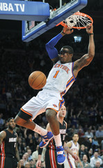 New York Knicks' Stoudemire dunks against the Miami Heat during the first quarter of their NBA basketball game in New York