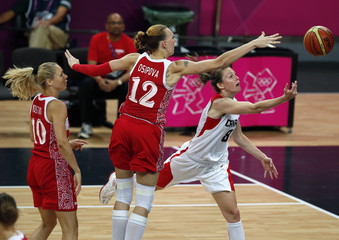 Russia's Irina Osipova and Canada's Kim Smith fight for the ball during the women's Group B basketball match at the London 2012 Olympic Games