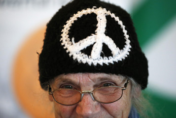 A CND (Campaign for Nuclear Disarmament) activist wears a woolly hat its campaign logo while attending the opening day of the Green party's spring conference in Liverpool northern England