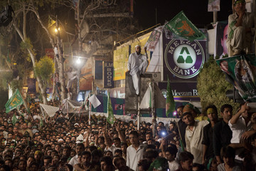 Supporters of the Pakistan Muslim League - Nawaz take part in an election campaign rally in Islamabad