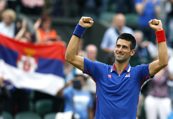 Serbia's Djokovic celebrates after winning his men's singles tennis match against Roddick of the U.S. at the All England Lawn Tennis Club during the London 2012 Olympic Games