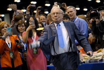 Berkshire Hathaway CEO Warren Buffett participates in a newspaper throwing contest prior to the Berkshire annual meeting in Omaha