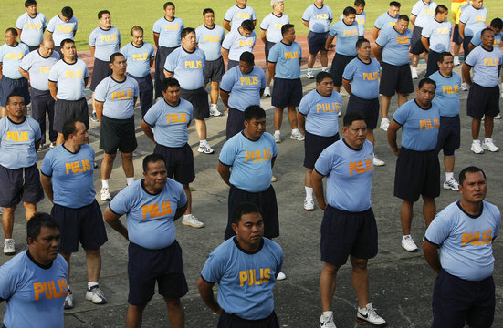 Police officers take part in the Weight Loss Management Program at Camp Crame in Quezon City Metro Manila
