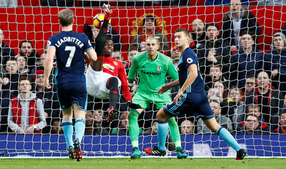 Manchester United's Paul Pogba hits the post with a overhead kick as Middlesbrough's Victor Valdes looks on