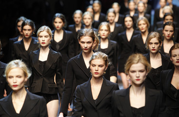Models walk on the catwalk at the end of Dolce&Gabbana Fall/Winter 2010/11 women's collection fashion show during Milan Fashion Week