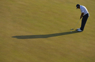Angel Cabrera of Argentina putts during the second round of the British Open golf Championship at Muirfield in Scotland