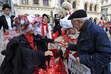 A man receives condoms during an information campaign in downtown Lisbon