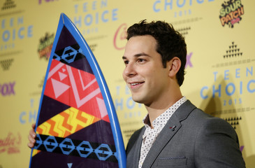 Actor Skylar Astin poses backstage with his award for Choice Movie Actor: Comedy at the 2015 Teen Choice Awards in Los Angeles
