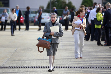 A woman walks to enter a line for the Nassau County Mega Job Fair at Nassau Veterans Memorial Coliseum in Uniondale, New York