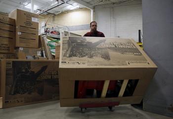 Lowe's employee Sanderson takes unassembled snow blower to selling floor at Lowes store in Kentlands Maryland