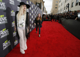 Singer Ke$ha arrives at the 2013 MTV Movie Awards in Culver City, California