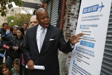 "Brooklyn Borough President Eric L. Adams points at an Ebola advisory board during a news conference outside the bar and bowling venue ""The Gutter"", in New York"