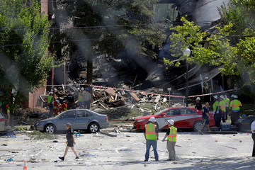 Fire fighters look through the debris of a four-story building that was destroyed in an explosion that has left up to seven people missing in Silver Spring, Maryland.
