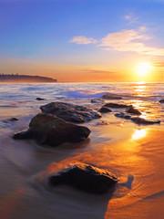Seawater flowing into rocks at Curl Curl beach, Sydney, Australia.