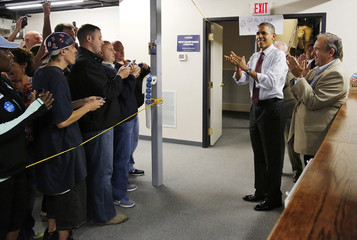 U.S. President Obama applauds supporters at the Teamsters Union Local 633 in Manchester, New Hampshire