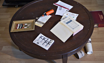 Both Muslim and Christian religious material is seen on a table of the apartment rented to suspects Nuttall and Korody in Surrey