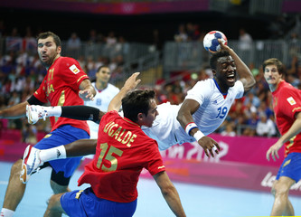 France's Luc Abalo takes a shot in his men's handball quarterfinals match against Spain at the Basketball Arena during the London 2012 Olympic Games