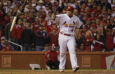 St. Louis Cardinals' Molina throws his bat after drawing a walk with the bases loaded against the Texas Rangers during the fifth inning in Game 7 of MLB's World Series baseball championship in St. Louis