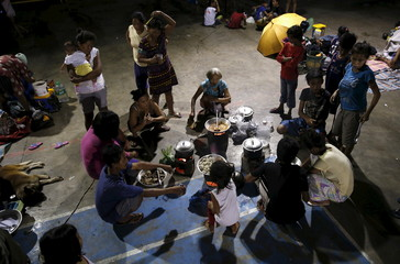 Typhoon victims cook their meal at a public school turned into an evacuation centre in Cabanatuan city
