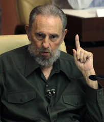 Former Cuban leader Fidel Castro gestures during a meeting of the National Assembly in Havana