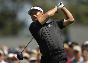 K.J. Choi hits his tee shot on the first hole during final round play in the 2010 Masters golf tournament at the Augusta National Golf Club