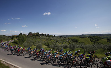 The pack of riders cycle during the 255-km 11th stage from Assisi to Montecatini Terme of the Giro d'Italia