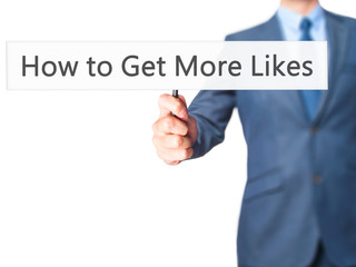 How to Get More Likes - Businessman hand holding sign