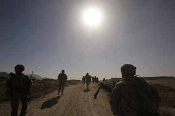 U.S. Army soldiers walk back to their camp after a joint U.S.-Afghan military patrol in Arghandab Valley