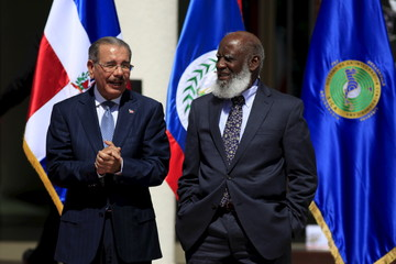 Dominican Republic's President Danilo Medina Sanchez and Belize's Minister of Foreign Affairs Wilfred Elrington (L) pose for a group picture during the Presidential Summit of the Central American Integration Sistem SICA in San Salvado