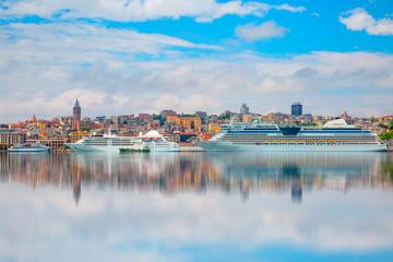 Luxury cruise ship in Bosporus against galata tower, Istanbul
