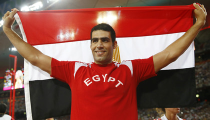 Second placed El Sayed of Egypt celebrates with a national flag after winning silver at the men's javelin throw final during the 15th IAAF World Championships at the National Stadium in Beijing