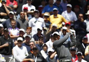 Tiger Woods of the U.S. tees off on the sixth hole during the first round of the 2012 U.S. Open golf tournament on the Lake Course at the Olympic Club in San Francisco