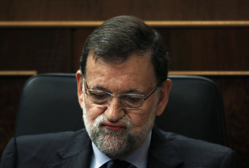 Spain's PM Rajoy reacts during a government control session at Spain's Parliament in Madrid