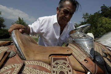 Jaime Rodriguez, governor-elect of Nuevo Leon state, gets on his horse inside his house before the official ceremony of delivery constancy as governor from the State Election Commission (CEE) in Monterrey
