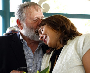 Tretheway, author of three poetry collections and winner of Pulitzer Prize, hugs her father Eric after she was named 19th U.S. poet laureate,during celebration in Decatur, Georgia