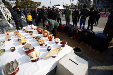 People bow in the direction of the North during a memorial service for their North Korean familly members near the demilitarized zone separating the two Koreas, in Paju