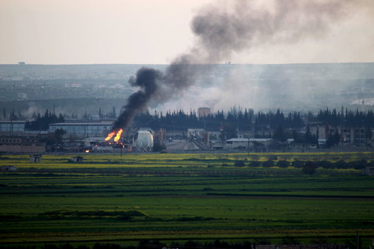 Smoke rises from a Gas refinery after what activists said were airstrikes by forces loyal to Syria's president Bashar Al-Assad on the entrance to Idlib city