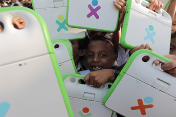 Schoolchildren hold their XO laptop at the Municipal Stadium in Ciudad Sandino on the outskirts of Managua.