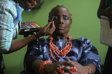 """Nigerian actress Ajayi-Lycette gets make-up applied on her before filming a scene for """"Dazzling Mirage"""", on the outskirts of Lagos"""