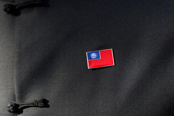 A man wears a pin of the flag of Taiwan during Taiwanese President Tsai Ing-wen's stop-over after her visit to Latin America in Burlingame