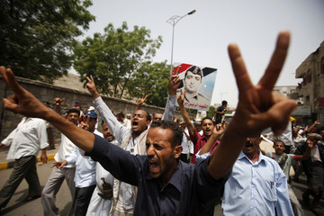 Anti-government demonstrators shout slogans as they demand the ouster of Yemen's President Ali Abdullah Saleh in the southern city of Taiz