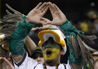 An Oregon Ducks fan show his team spirit before the NCAA BCS National Championship college football game against the Auburn Tigers in Glendale, Arizona