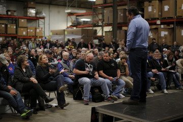 U.S. Republican presidential candidate Ted Cruz listens to a question from a woman during a campaign event in Wapello, Iowa, United States